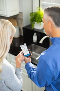 Culligan rep showing homeowner in Nevada Culligan Connect app