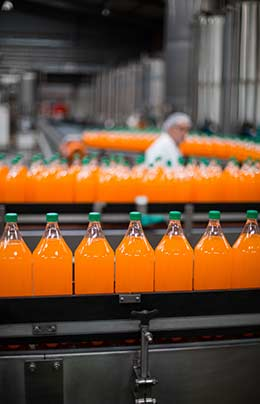 Orange drink processed from reverse osmosis purified water on bottle production line in Reno, Nevada