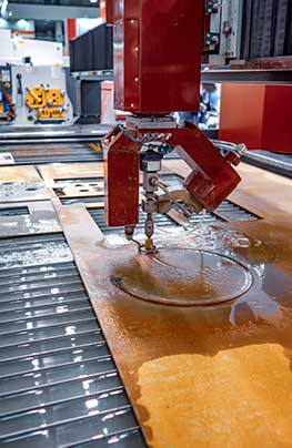 CNC water jet cutting machine at manufacturing facility using purified Culligan treated water Reno, Nevada