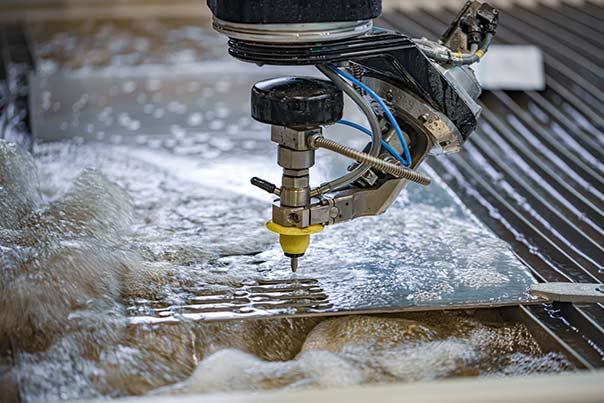 Manufacturing water systems and solutions by Culligan NV Commercial showing water jet cutting CNC machine